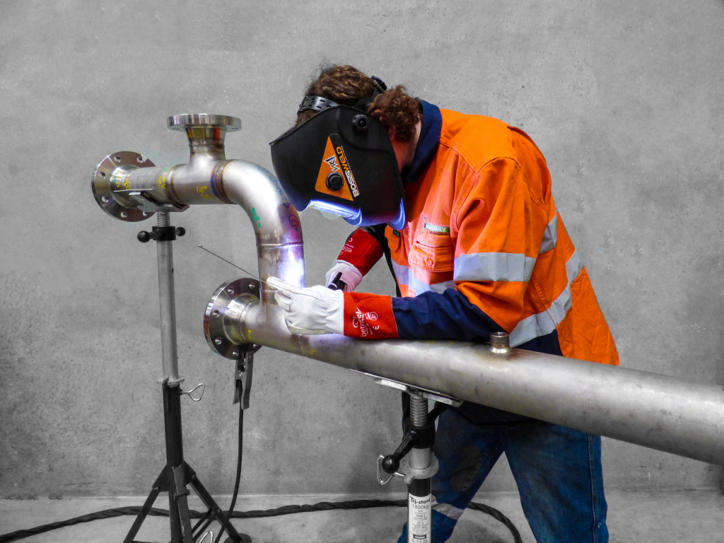 Stainless Steel Welding a pipe in the workshop at Murray Engineering