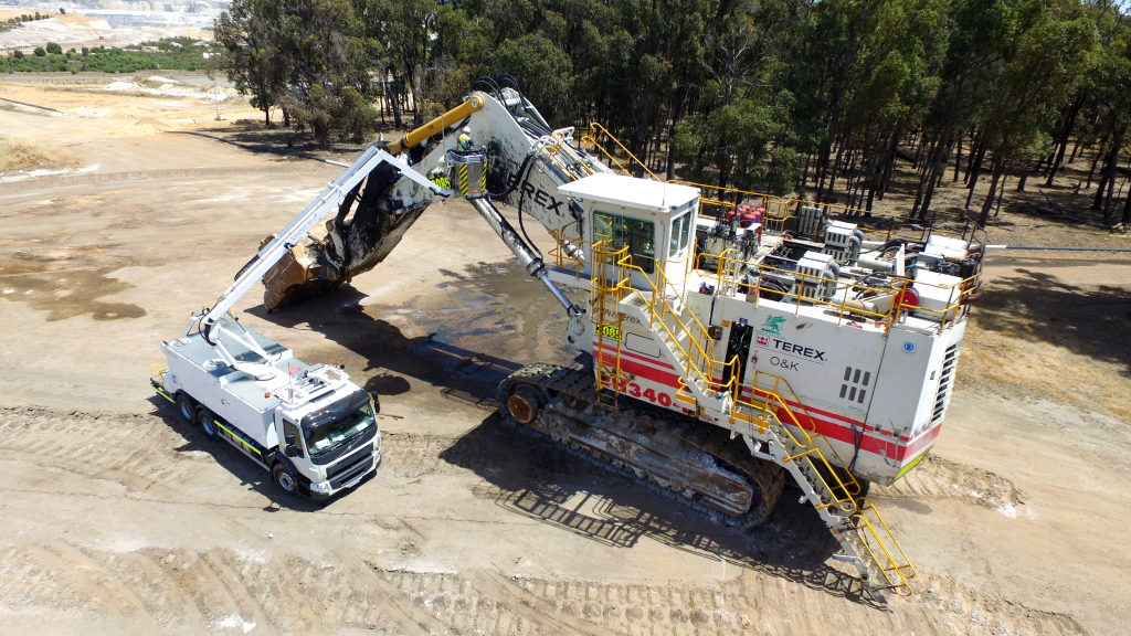 Mine Equipment Washer in action, washing a large mining machine. Available from Murray Engineering.