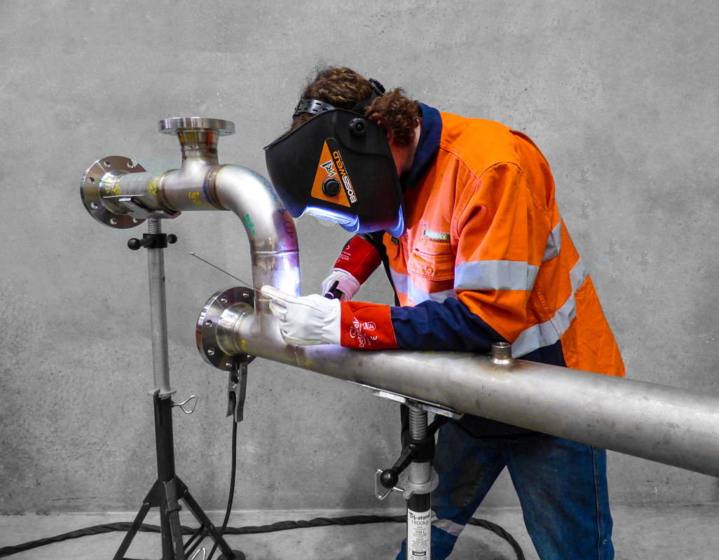 mining equipment fabrication services- Stainless Steel Welding a pipe in the workshop at Murray Engineering